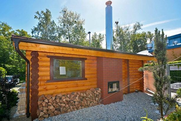 Popis: Nová srubová sauna.
